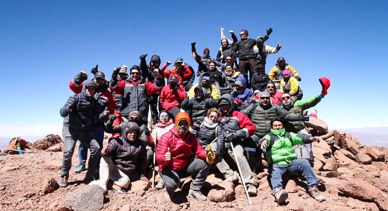 Sales de Jujuy employees sitting on top of Mount Tuzgle in Northern Argentina