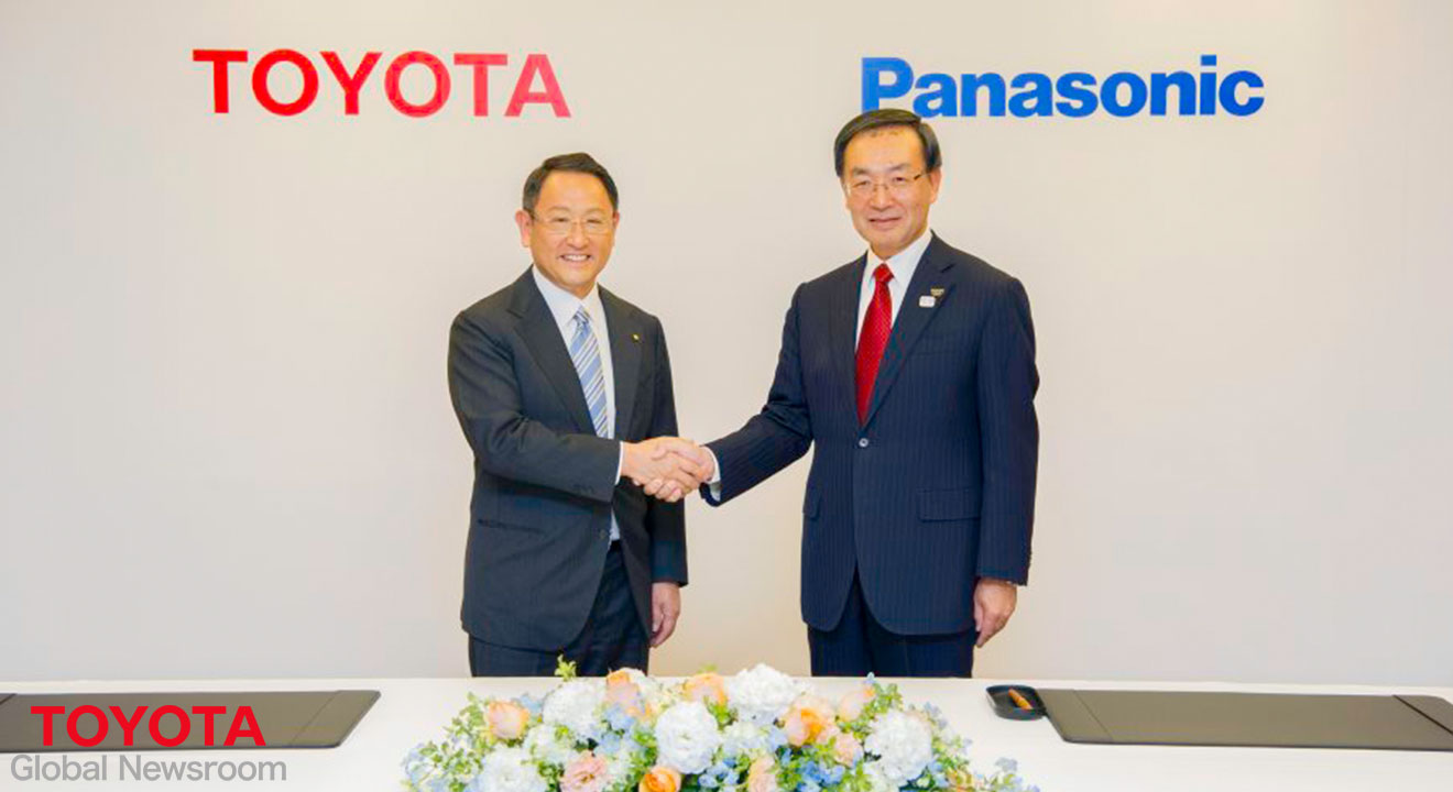 Toyota and Panasonic Executives shaking hands at joint venture agreement launch ceremony