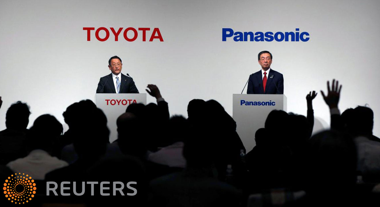 Toyota and Panasonic Executives presenting at a joint venture launch ceremony