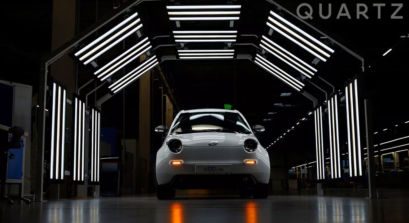 White Electric car coming off a Chinese production line