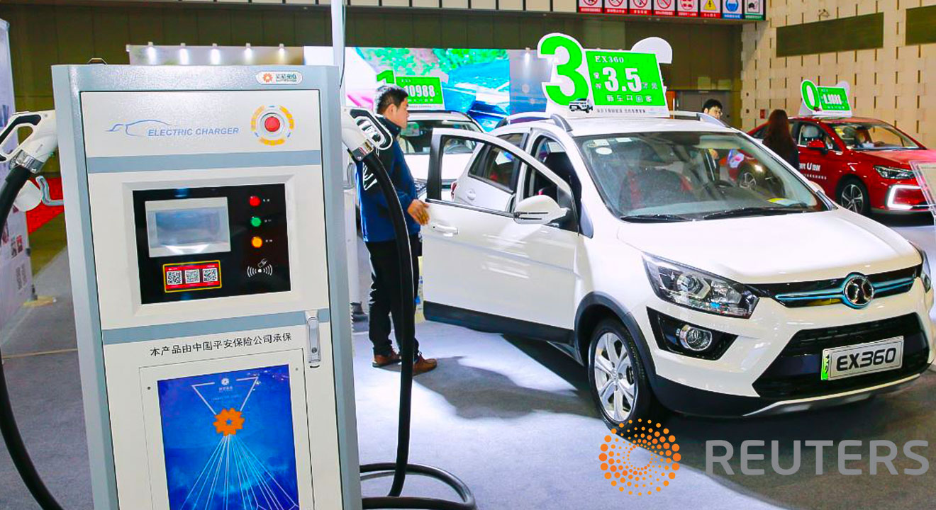Man shopping for a Chinese Electric Vehicle